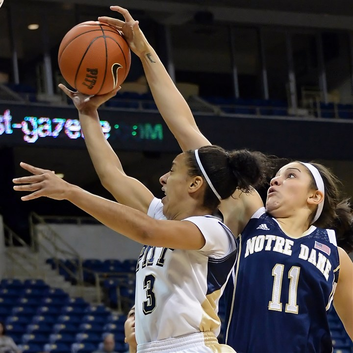 20140116mfpittsports02-1 Notre Dame's Natalie Achonwa blocks a shot by Pitt's Brianna Kiesel in the first half Thursday night at the Petersen Events Center.