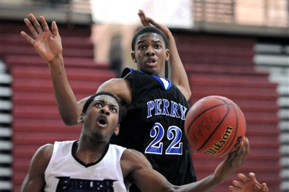 HS basketball, Obama vs. Perry Obama Academy's James Taylor-Lane, left, has his shot blocked by Perry's Jaewon Mitchell, but Obama Academy remained undefeated with a 61-52 win Friday.