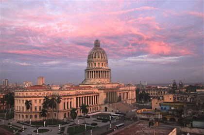 20140117psCubaSeen9-13 Morning breaks over the former capital building in Havana. It is an exact replica of the U.S. Capitol and now abandoned as the seat of government because it is viewed as a symbol of corruption.