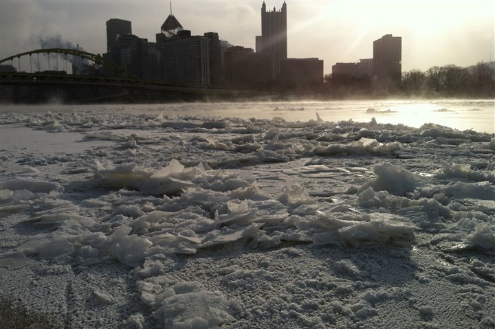 20140117freeze2-1 A view of the Pittsburgh skyline with ice lining the Allegheny River along the North Shore.