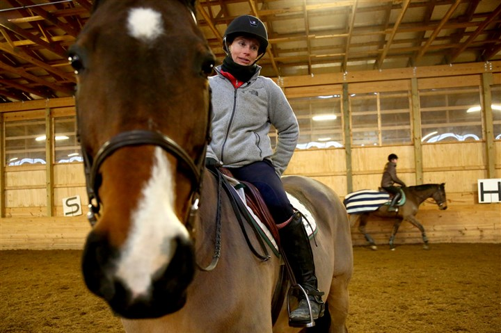 Horses at Cedar Run Farm 01 Dana Friday, co-owner of Cedar Run Farm, an equestrian and horse boarding facility in Indiana Township, rides Miro, whose show name is Leandro.