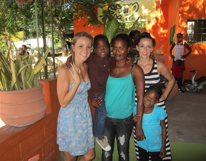 20140117hoMcMutrieBiz2-1 Ali and Jamie McMutrie with Jeta, one of three staff members employed at Haitian Families First, and Jeta's children Kervens, left, and Gloria.