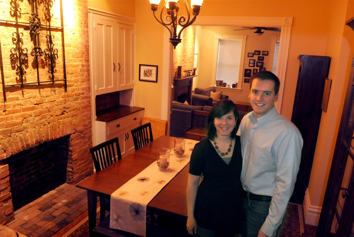 Jones Tim & Katie Jones stand in the dining room of their Lawrenceville rowhouse.