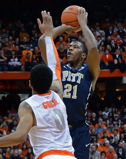 Lamar Patterson; Michael Gbinije Pitt's Lamar Patterson gets a three-point shot up against Syracuse' Michael Gbinije.