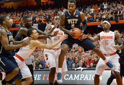 Pitt's Michael Young Pitt's Michael Young pulls down a rebound against Syracuse in the second half at the Carrier Dome.