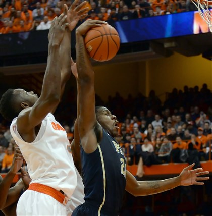 Lamar Patterson; Jerami Grant Pitt's Lamar Patterson pulls down a rebound against Syracuse' Jerami Grant in the second half.