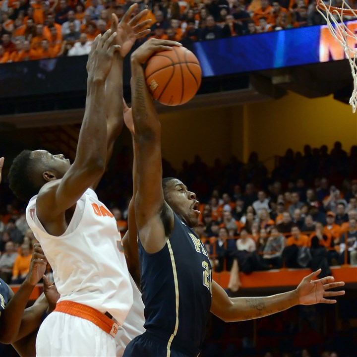 Lamar Patterson; Jerami Grant Pitt's Lamar Patterson pulls down a rebound against Syracuse's Jerami Grant Saturday at the Peterson Event Center.