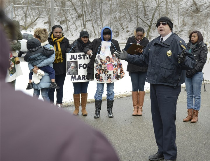 20140118ppRally2LOCAL-1 Pittsburgh police Cmdr. Timothy O'Connor speaks Saturday during a rally seeking justice for Marcus L. White Jr., a baby shot to death during a picnic in the East Hills.