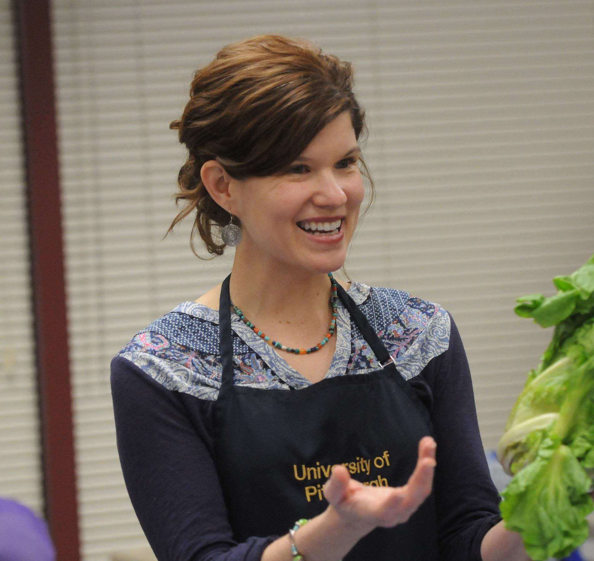 20140118ttCookingFood1 Assistant Professor Liz Ruder, R.D., holds a bunch of escarole as she leads a PrepAbility cooking class.