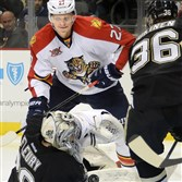 Penguis goalie Marc-Andre Fleury makes a save on the Panthers' Nick Bjugstad.