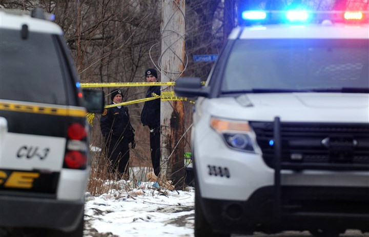 20140120MWHshootingLocal01 Police investigate the scene of a homicide on Rapidan Way in Larimer.