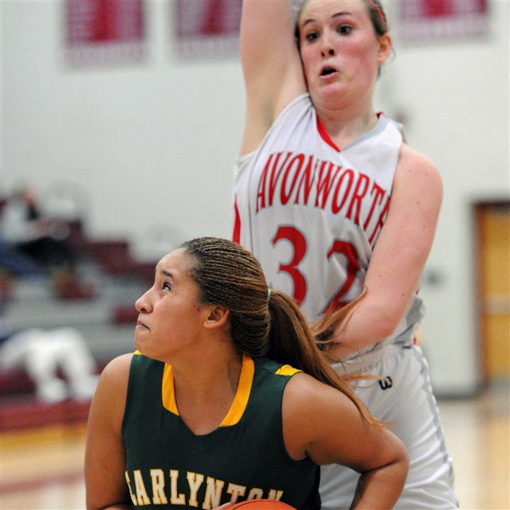 hshigh0121 Avonworth's Mackenzie Mayernik towers over Jasmyn Meredith of Carlynton in the second half Monday night in a Class AA, Section 6 game at Avonworth.