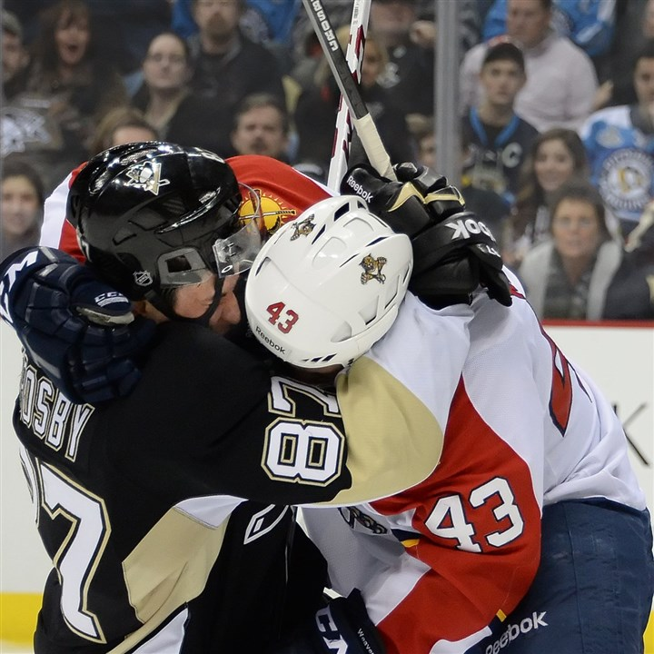 cook0121 A frustrated Sidney Crosby puts Florida's Mike Weaver in a headlock in front of the net in the third period Monday night at Consol Energy Center.