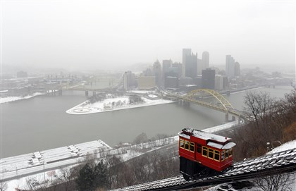 Duquesne Incline The Duquesne Incline moves down Mount Washington on a snowy, cold Tuesday afternoon.