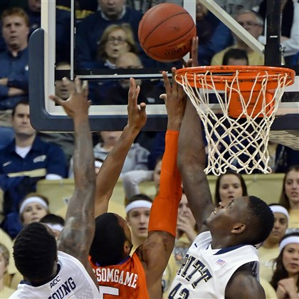 20140121mfpittsports04-3 Pitt forward Talib Zanna blocks a shot by Clemson forward Jaron Blossomgame in the first half at the Petersen Events Center.