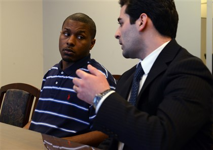 DeAndre Brown and his attorney DeAndre Brown, left, and his attorney, Massimo Terzigni, discuss Mr. Brown's case. Mr. Brown was wrongfully arrested in September for armed robbery and forced to sit in jail for a month because police ignored his alibi.