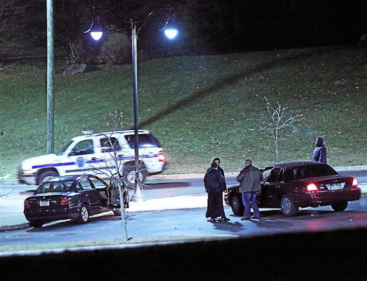 Widener Campus Shooting Police investigate a car, left, at the athletic center of Widener University after a student was shot on Monday.