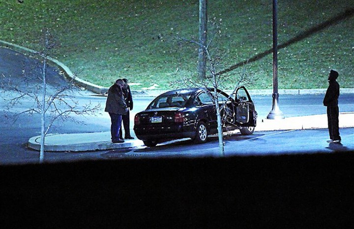Widener Campus Shooting Police investigate a car, left, at the athletic center of Widener University after a student was shot on Monday. Authorities warned students to remain indoors until further notice.