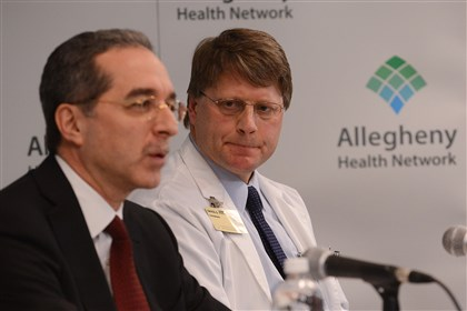AHN, Johns Hopkins press conference 03 David Parda, right, chairman of the Allegheny Health Network Cancer Institute, listens to Tony Farah, AHN chief medical officer, answer a question Wednesday about an affiliation between AHN and the Johns Hopkins Kimmel Cancer Center.