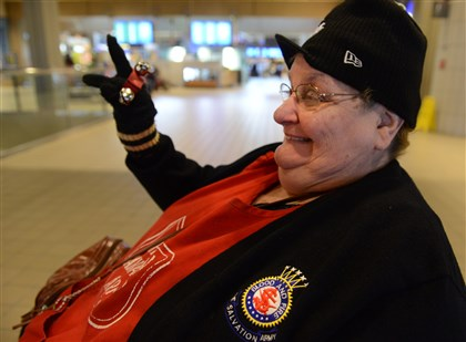 Marilyn Darnley Marilyn Darnley rings her bells at people entering the Pittsburgh International Airport.
