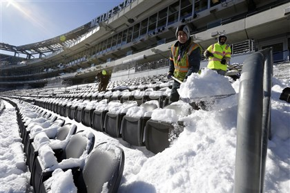 cold super bowl Workers shovel snow off the seating area at MetLife Stadium as crews removed snow ahead of Super Bowl XLVIII following a snow storm, Wednesday, Jan. 22, 2014, in East Rutherford, N.J. Super Bowl XLVIII, which will be played between the Denver Broncos and the Seattle Seahawks on Feb. 2, will be the first NFL title game held outdoors in a city where it snows.