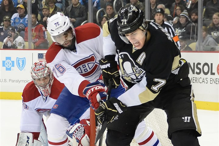 Evgeni Malkin The Penguins' Evgeni Malkin is hooked by the Canadiens' P.K. Subban in last night's game, which the Penguins won, 5-1.