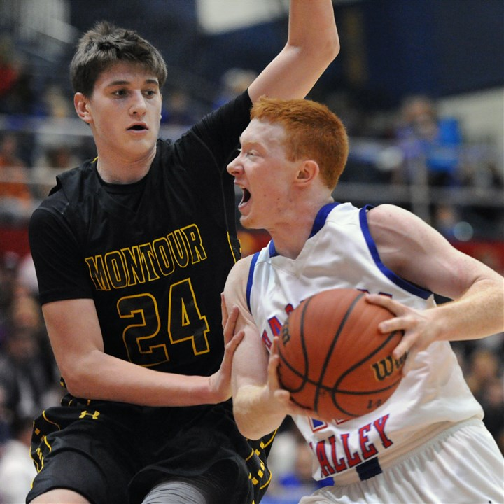 Dustin Sleva Montour's Dustin Sleva, left, guards Char Valley's Jerrad Tuite as he drives to the hoop.