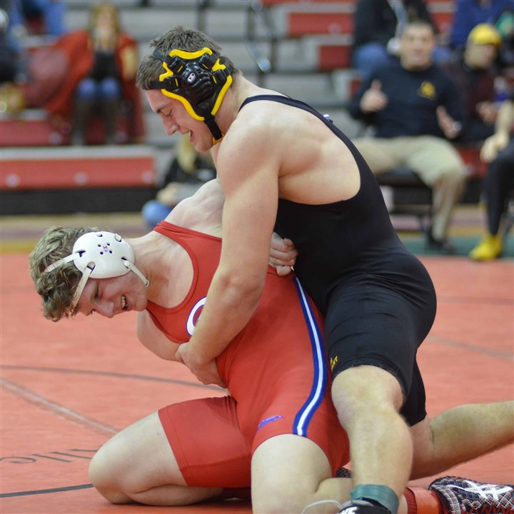 20140120ho220Best1zspts.jpg North Allegheny's Layne Skundrich, right, defeated Chartiers Valley's Michael Roper, 3-0, in the 220-pound weight class final of the Allegheny County tournament.