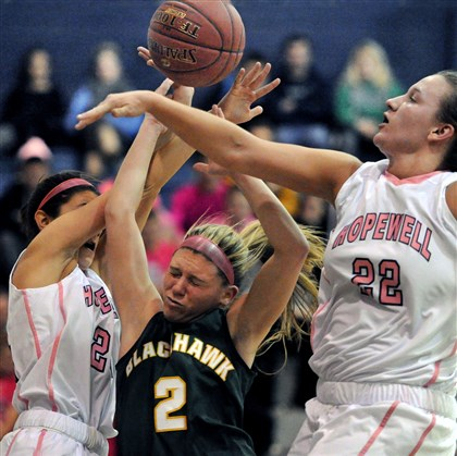 Blackhawk vs. Hopewell Blackhawk's Chassidy Omogrosso, center, is fouled by Hopewell defenders Chelsea Sundy, left, and Kari Steuer, right, in the second quarter Thursday night.