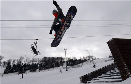 Man snowboards at Seven Springs terrain park 02 Jason Anderson, 19, of Harrisonburg, Va., snowboards on the Streets terrain park on the front face of Seven Springs.