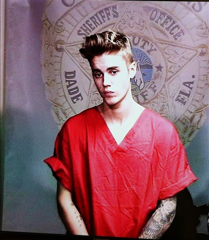 Justin Bieber Arrest Justin Bieber appears in court via video feed, Thursday, Jan. 23, 2014, in Miami. Bieber was released from jail Thursday following his arrest on charges of driving under the influence, driving with an expired license and resisting arrest.