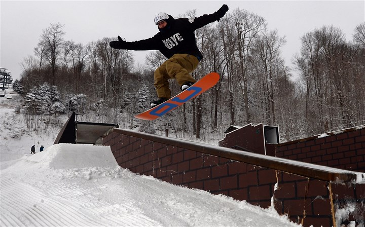 Man snowboards at Seven Springs terrain park David Hormby, 23, of Rockville, Md., snowboards on the Streets terrain park on the front face of Seven Springs.