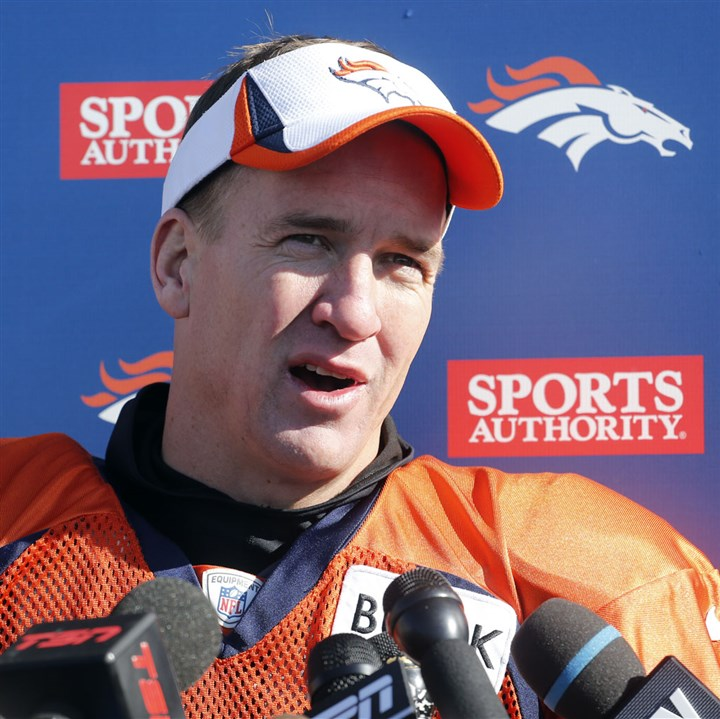 PEYTON Denver Broncos quarterback Peyton Manning talks to the media after NFL football practice at the team's training facility in Englewood, Colo., on Thursday, Jan. 23, 2014. The Broncos are scheduled to play the Seattle Seahawks in Super Bowl XLVIII on Feb. 2.