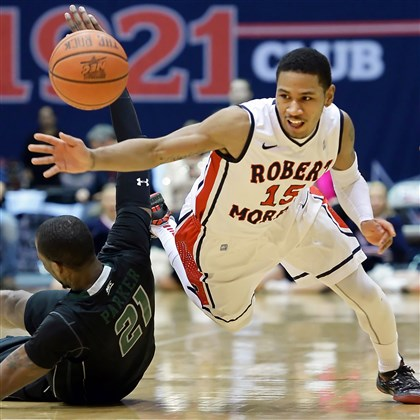 RMU's Karvel Anderson tries to steal Robert Morris' Karvel Anderson reaches to steal a ball from Wagner's Orlando Parker in the first half at the Sewall Center.