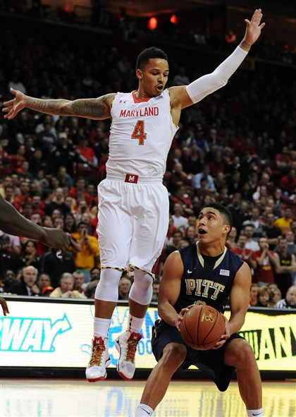 Pittsburgh-Maryland Basketball Maryland's Seth Allen, left, jumps to block as Pittsburgh's James Robinson looks to shoot in the first half.