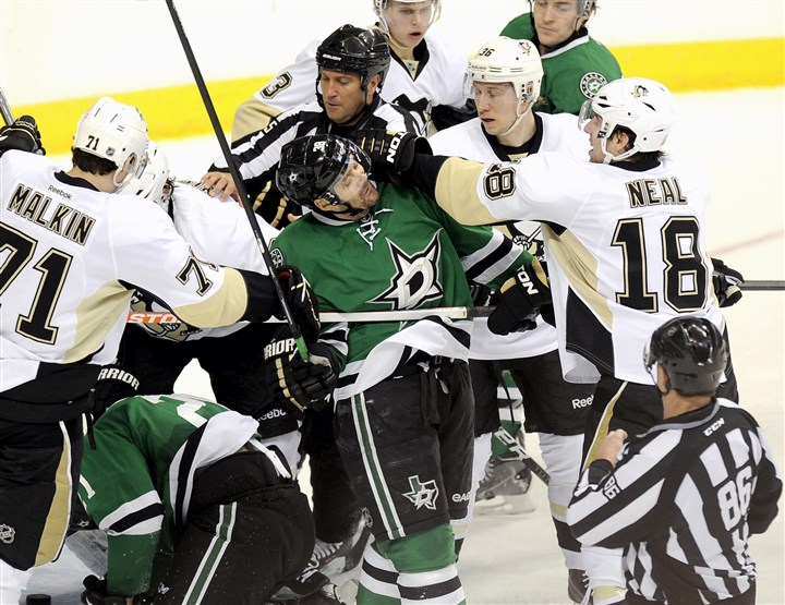 Fight breaks out between Pittsburgh Penguins, Dallas Stars players Players from both teams are separated as the Penguins' left wing James Neal (18) and Dallas Stars center Vernon Fiddler (38) exchange punches in the first period.
