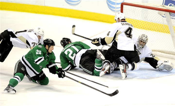Dallas Stars center Cody Eakin and Penguins goalie Marc-Andre Fleury Dallas Stars center Cody Eakin (20) tries to get a shot off Penguins goalie Marc-Andre Fleury in the second period.