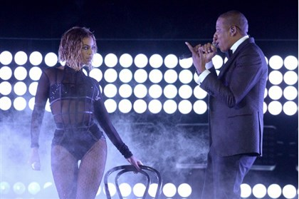2014BeyonceJayZGrammys0126 Beyonce and Jay Z perform the opening of the 2014 Grammy Awards.