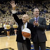 Dick Groat acknowledges the crowd after being honored by Duke head coach Mike Krzyzewski and Pitt head coach Jamie Dixon in 2014 at Petersen Events Center.
