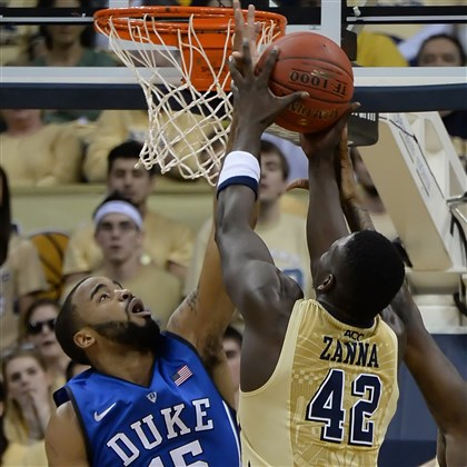 pitt0129 Pitt's Talib Zanna pulls down a rebound against Duke's Josh Hairston in the first half Monday night at Petersen Events Center.