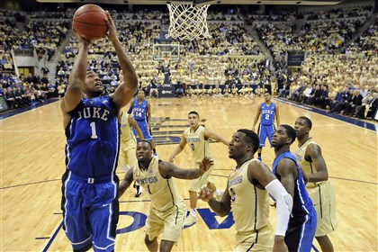 20140127mfpittsports08-2 Duke's Jabari Parker drives to the net against Pitt in the first half at the Petersen Events Center Monday night.