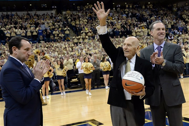 20140127mfpittsports12-2 Pitt's Dick Groat acknowledges the crowd after being honored by Duke head coach Mike Krzyzewski and Pitt head coach Jamie Dixon at the Petersen Events Center Monday night.