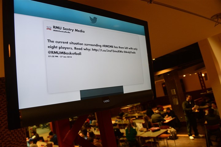 20140127MWHscreensEdTab01-2 Television screens display campus Twitter feeds inside Robert Morris University's Nicholson Center food court in January.