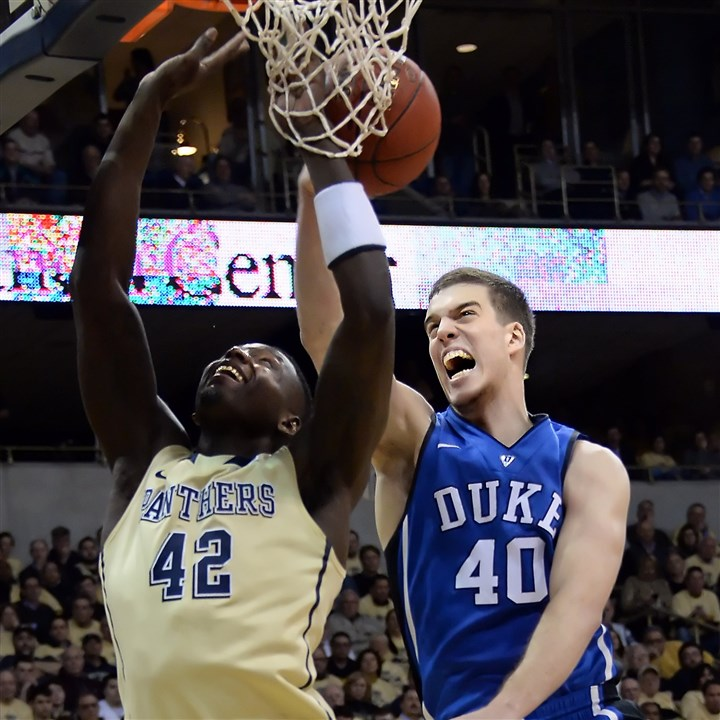 20140127mfpittsports01 Duke's Marshall Plumlee blocks a shot by Pitt's Talib Zanna in the first half at the Petersen Events Center Monday night.