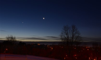 Venus and moon The planet Venus sits to the left of the crescent moon in a clear cold sky before sunrise in a view from Scott.