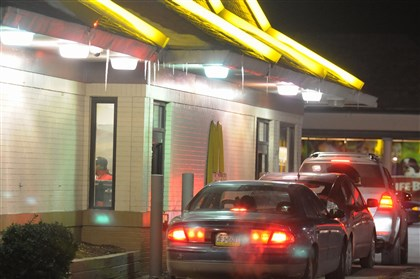 201401229McDonalds A woman was arrested Wednesday for distributing heroin from the drive-thru window in East Liberty.