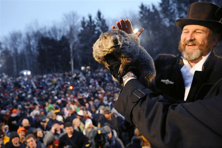 Punxsutawney Phil in 2008 Punxsutawney Phil gets a friendly pat from one of his handler, Ben Hughes, after seeing his shadow and predicting six more weeks of winter in 2008.