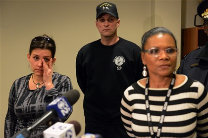 Officers, vets hold news conference after Rocco's death Staff surgeon Julie Compton of the Pittsburgh Veterinary Specialty & Emergency Center, left, Pittsburgh Police K-9 officer Dan Tice, and police spokeswoman Diana Richard speak to the media after the death of Pittsburgh police K-9 officer Rocco.
