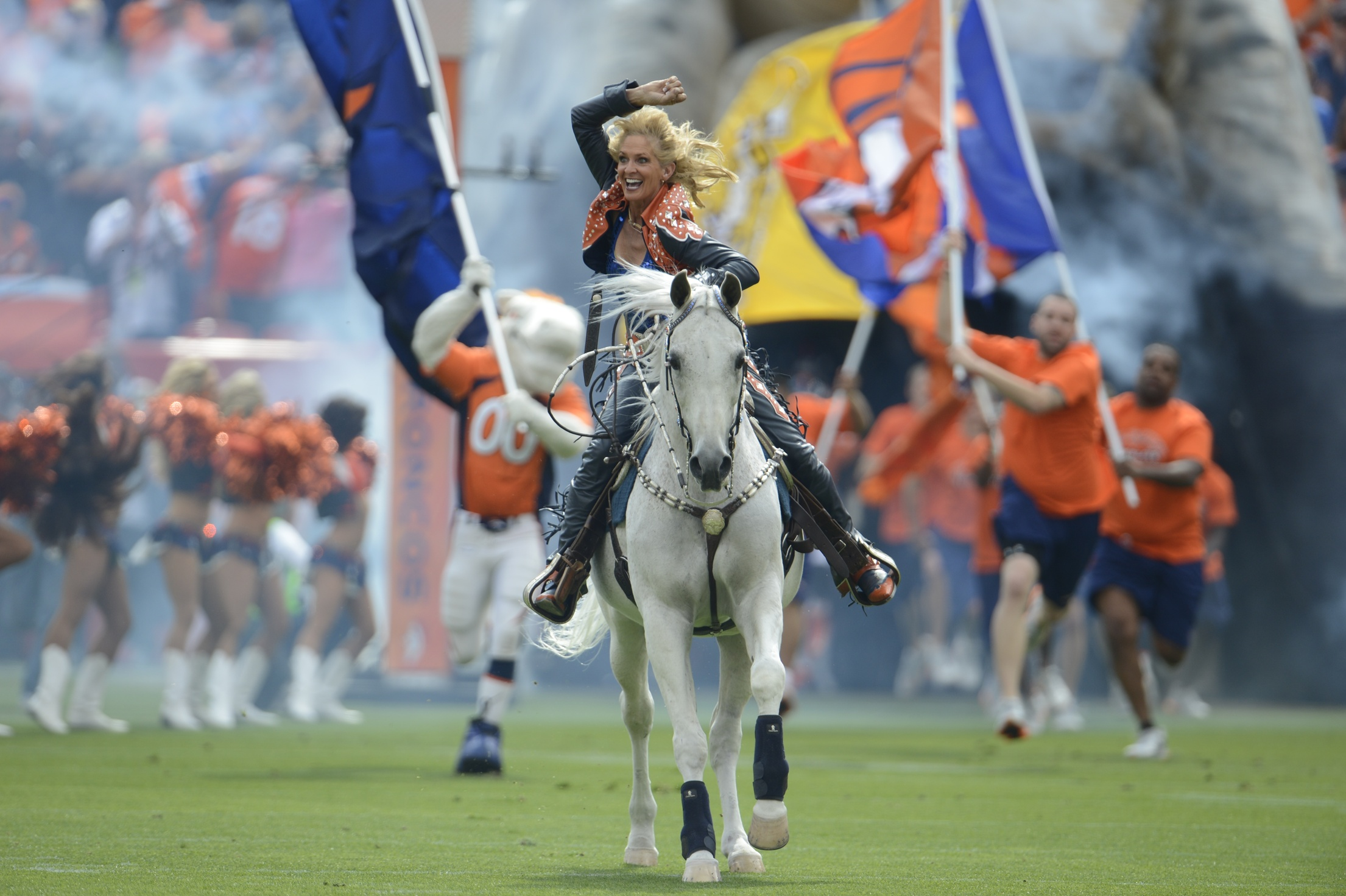 20140130hDPpettales0201mag Ann Judge-Wegener rides Thunder onto the field before the start of a Denver Broncos game.