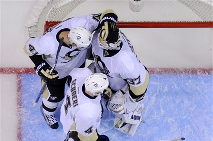 Penguins celebrate vs. Los Angeles Penguins defenseman Robert Bortuzzo, top left, congratulates goalie Jeff Zatkoff, upper right, as defenseman Rob Scuderi, center, left wing Tanner Glass, lower left, and defenseman Deryk Engelland look on Jan. 30 in Los Angeles.
